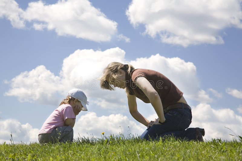 Care about flower. Mother and daughter watching flower stock image