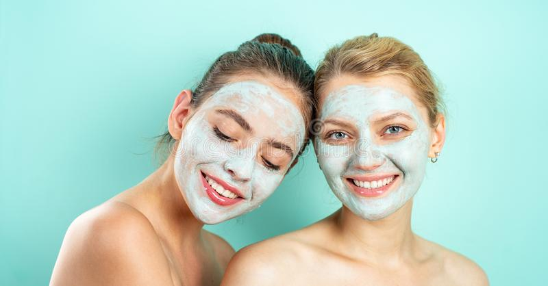 Care and fun. Spa and wellness. Girls friends sisters making clay facial mask. Anti age mask. Stay beautiful. Skin care royalty free stock photos