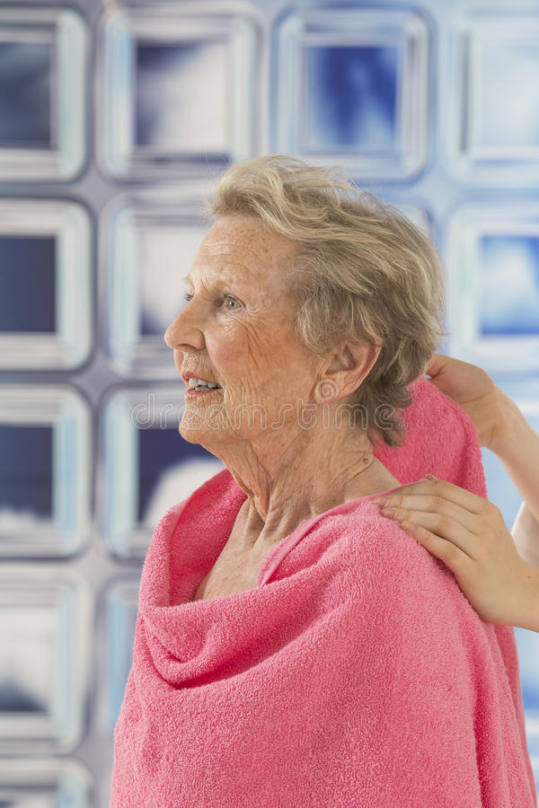 Care giver or nurse assisting elderly woman for shower. Care giver or nurse givng assistance to elderly woman for shower royalty free stock photos