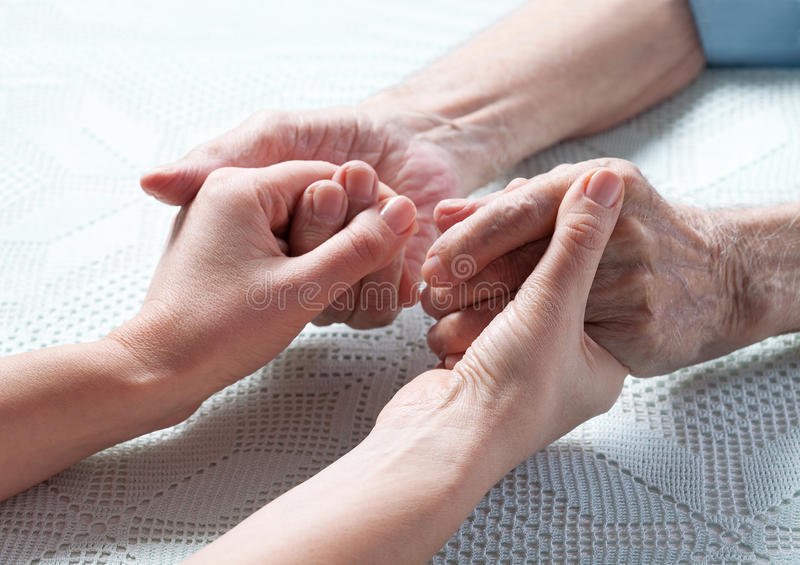 Care is at home of elderly. stock photos