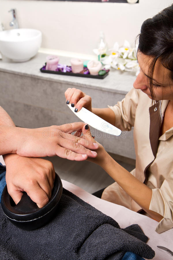 Download Care Of Man Nails And Manicure In Beauty Center Stock Image - Image: 35137571