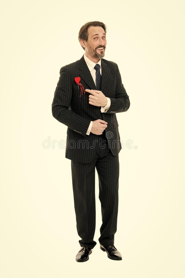 Care of my heart. Mature man well groomed beard and cheerful face. Bearded man smiling pointing heart. Dating, love and royalty free stock images