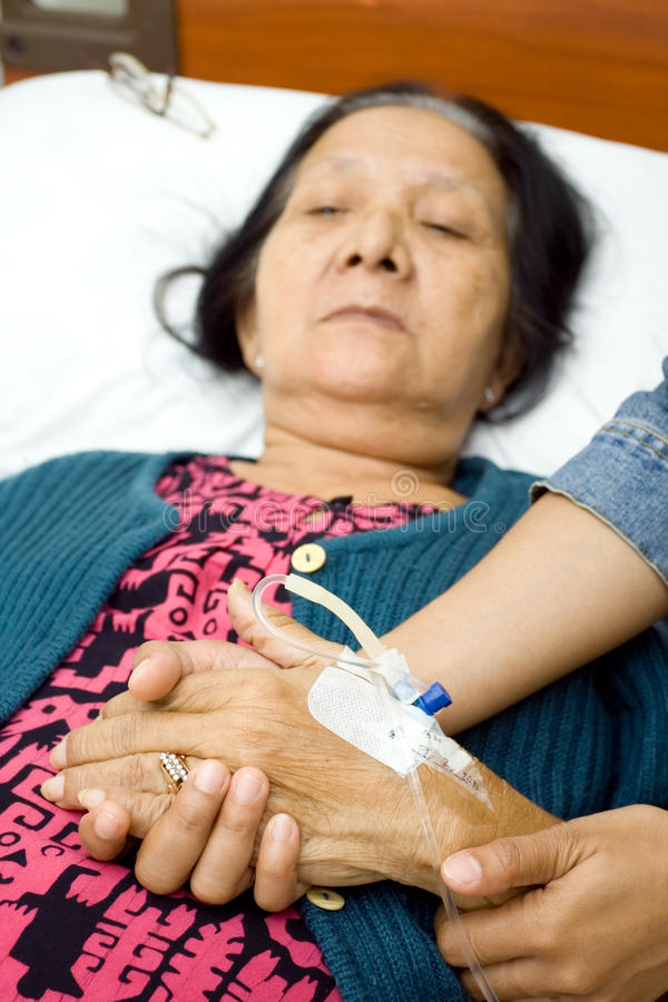 Care to old sick grandparent stock image