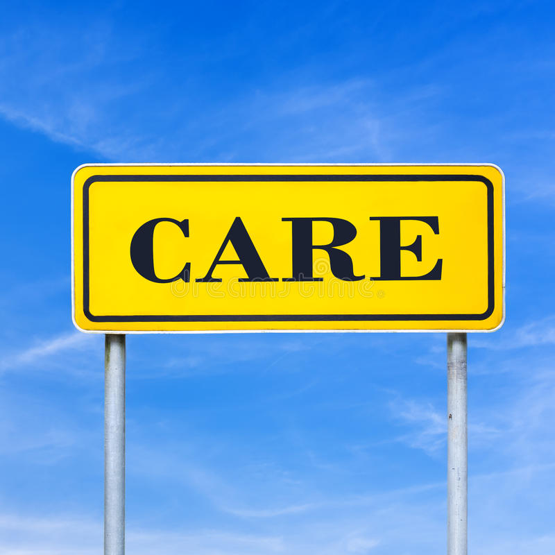 Care. Word Care written on yellow road sign stock photo