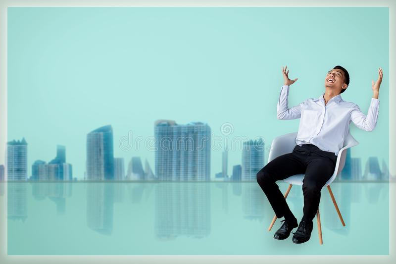 Career business man sitting chair Express feeling In gray room city blurry background Metaphor for Success finance Dealing buying royalty free stock images