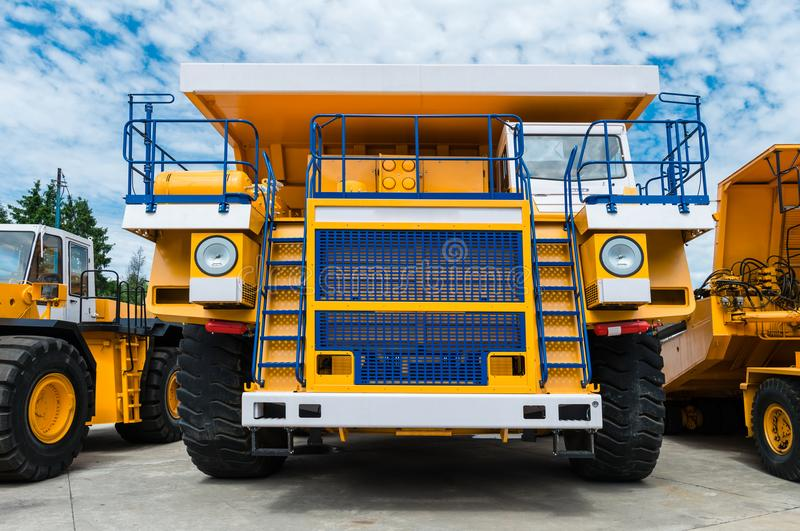Career dump truck on a sunny day, tested. Big yellow Career heavy-load car, dump truck royalty free stock images
