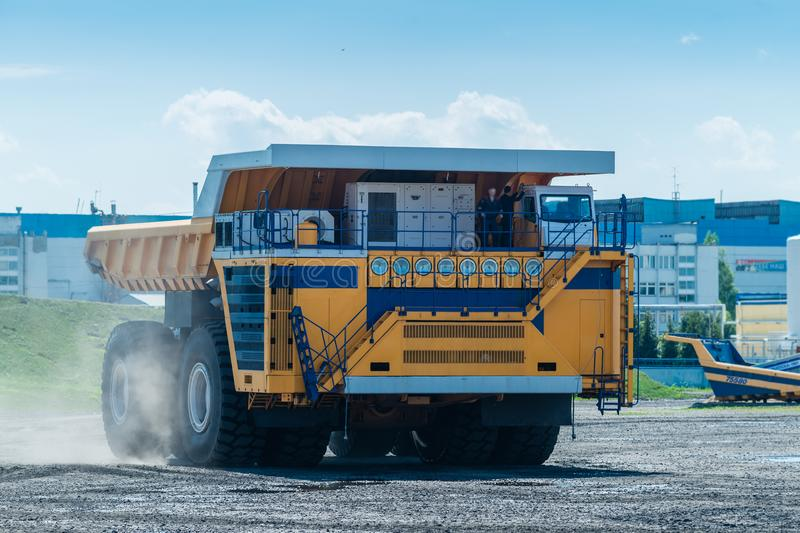 Career dump truck on a sunny day, tested. Big yellow Career heavy-load car, dump truck stock photo