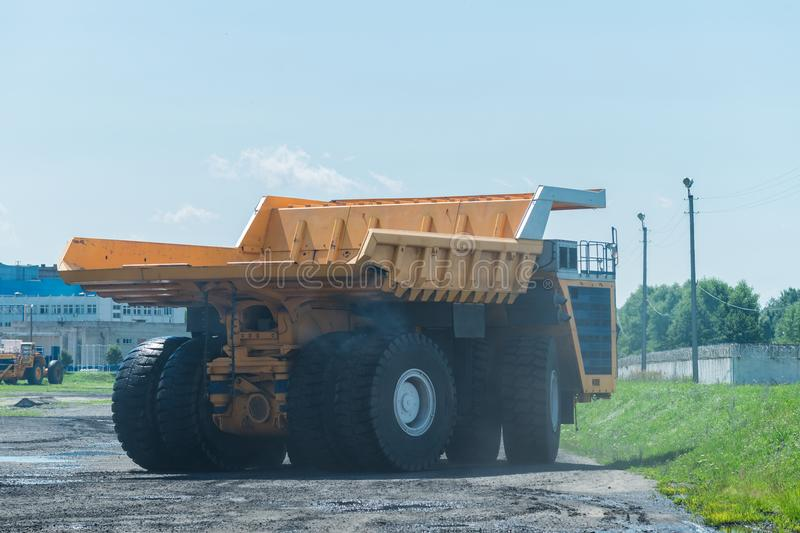 Career dump truck on a sunny day, tested. Big yellow Career heavy-load car, dump truck royalty free stock photography