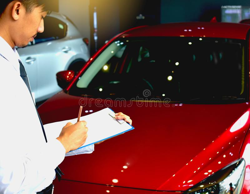 Career man saleman business inspection writing on notepad or book, paper with car blurry background.for transport automobile autom royalty free stock photos