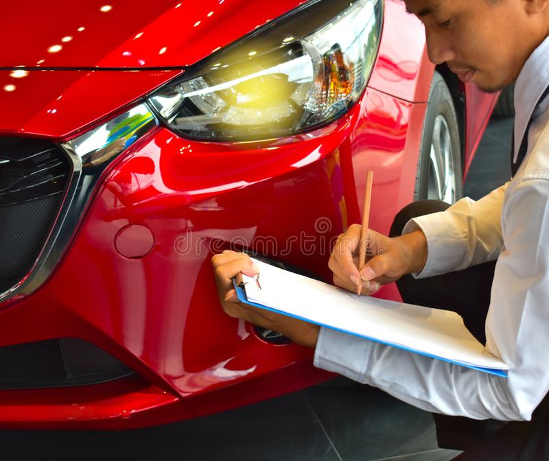 career man saleman business inspection writing on notepad or book, paper with car blurry background.for transport automobile autom royalty free stock image