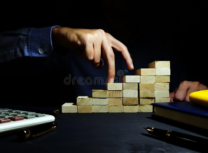 Career path. Stairs from wooden blocks and man. Career path concept. Stairs from wooden blocks and man royalty free stock photography