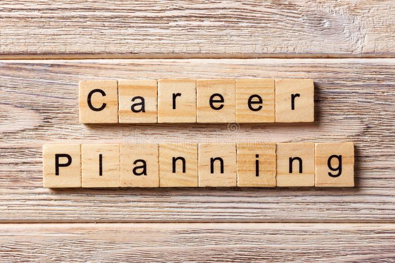 Career planning word written on wood block. career planning text on table, concept stock photo