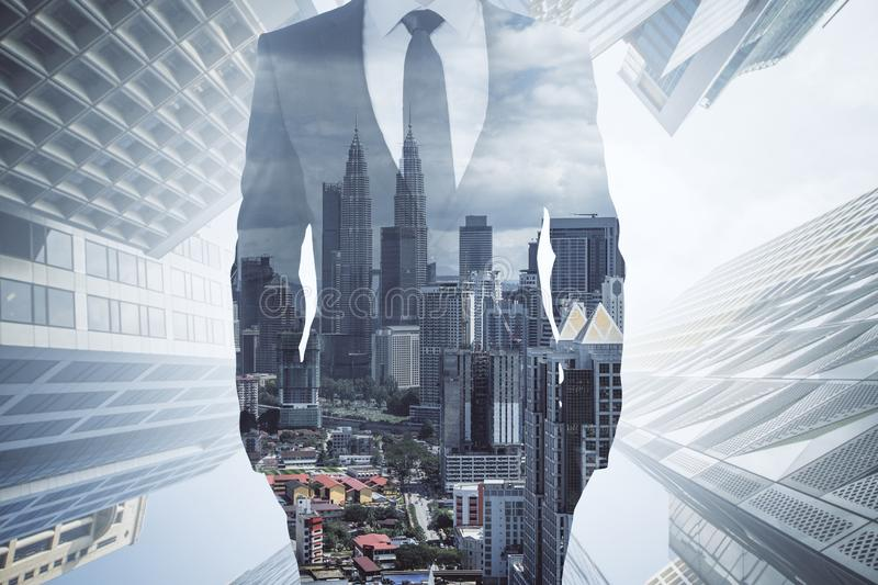Career and success concept. Unrecognizable businessman in suit standing on blurry city background. Career and success concept. Double exposure royalty free stock photos