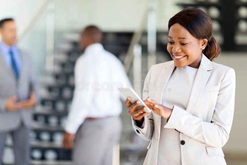 Career woman cell phone. Beautiful young african american career women using cell phone royalty free stock images