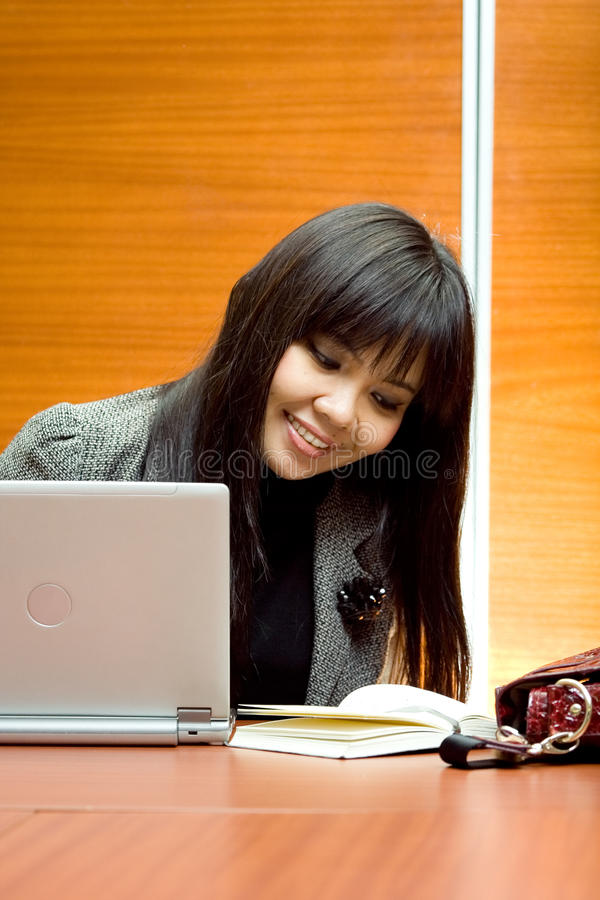 Download Career Woman Look At Agenda At The Office Stock Photo - Image: 12682208