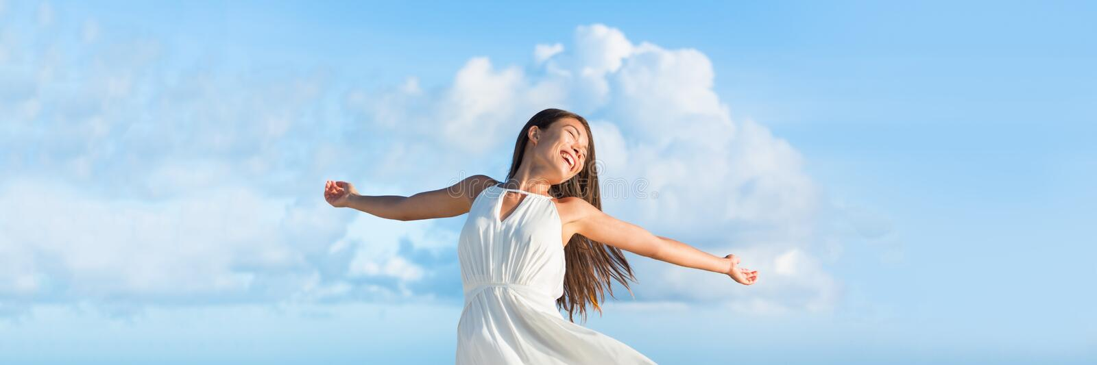 Carefee woman with open arms in freedom banner royalty free stock photos