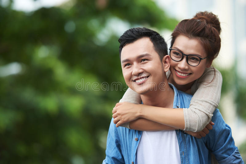 Carefree Asian Couple Enjoying Date Outdoors royalty free stock images