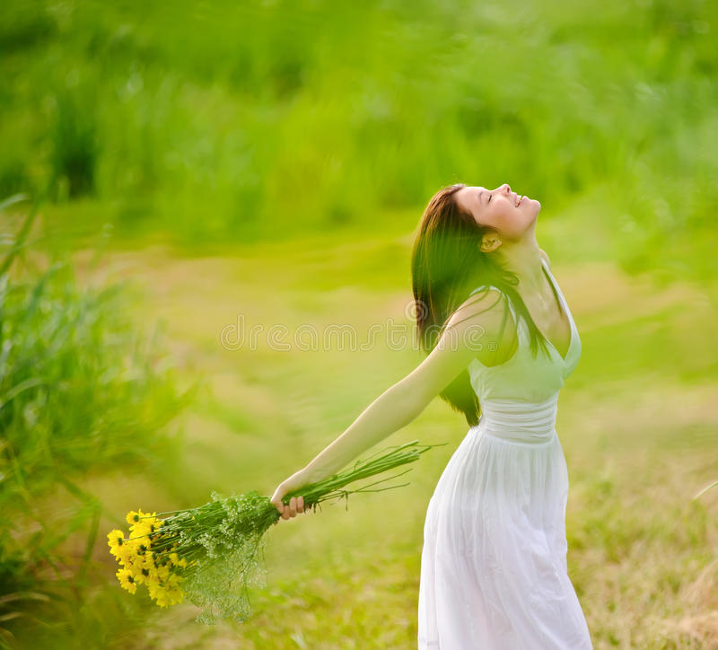 Carefree attractive girl in field royalty free stock photography