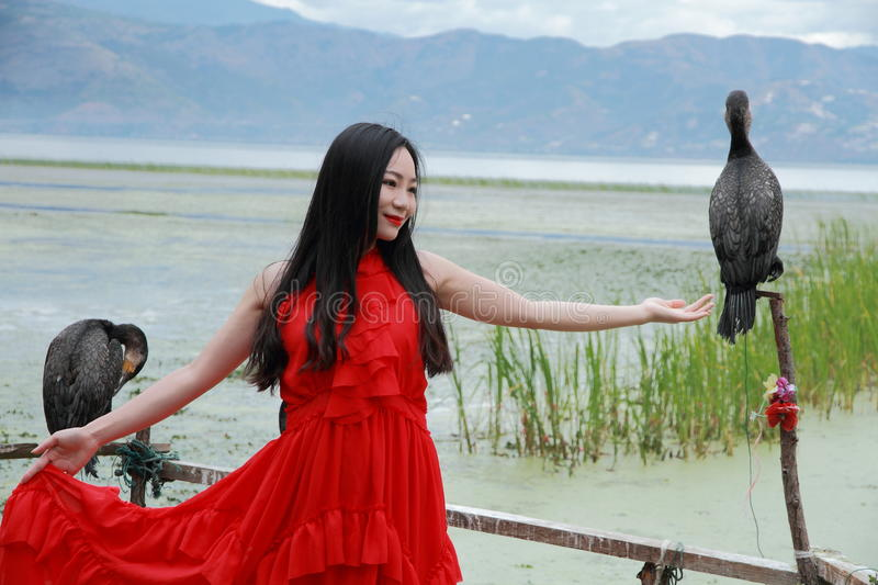 Carefree beauty at Yunnan Erhai, healthy living concept, pure happiness and freedom. Asian Chinese Carefree woman on snow mountain, healthy living concept, pure royalty free stock image