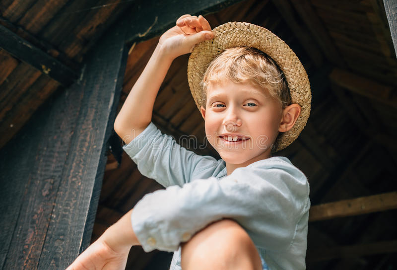 Carefree boy in straw hat royalty free stock photos