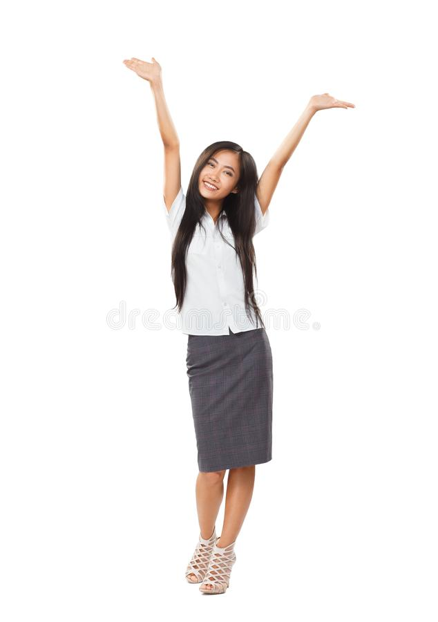 Carefree business Asian woman with lovely smile and hands up royalty free stock images