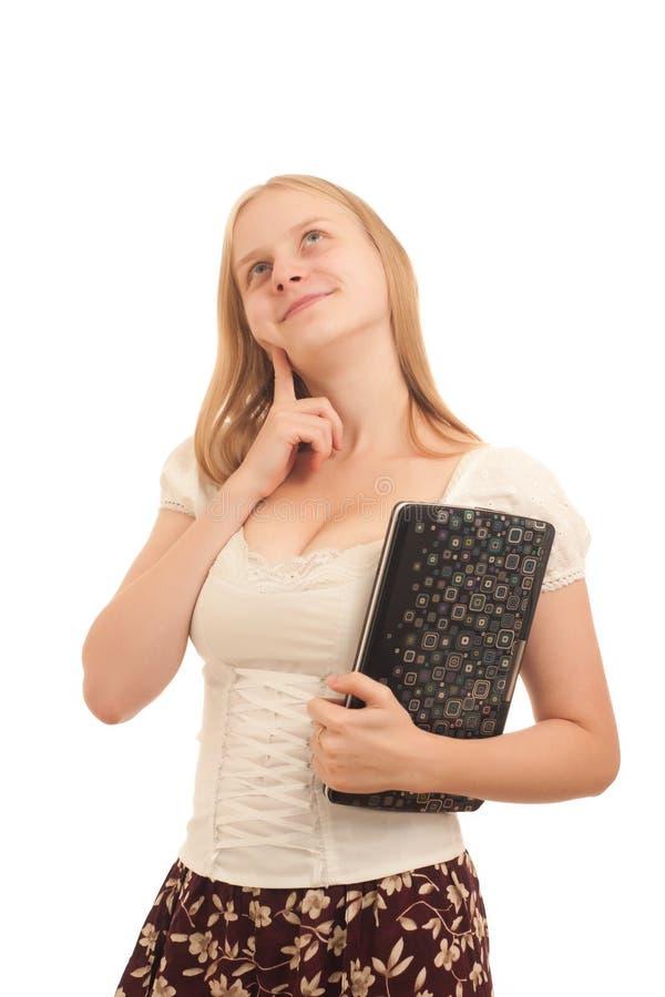 Carefree businesswoman holding laptop
