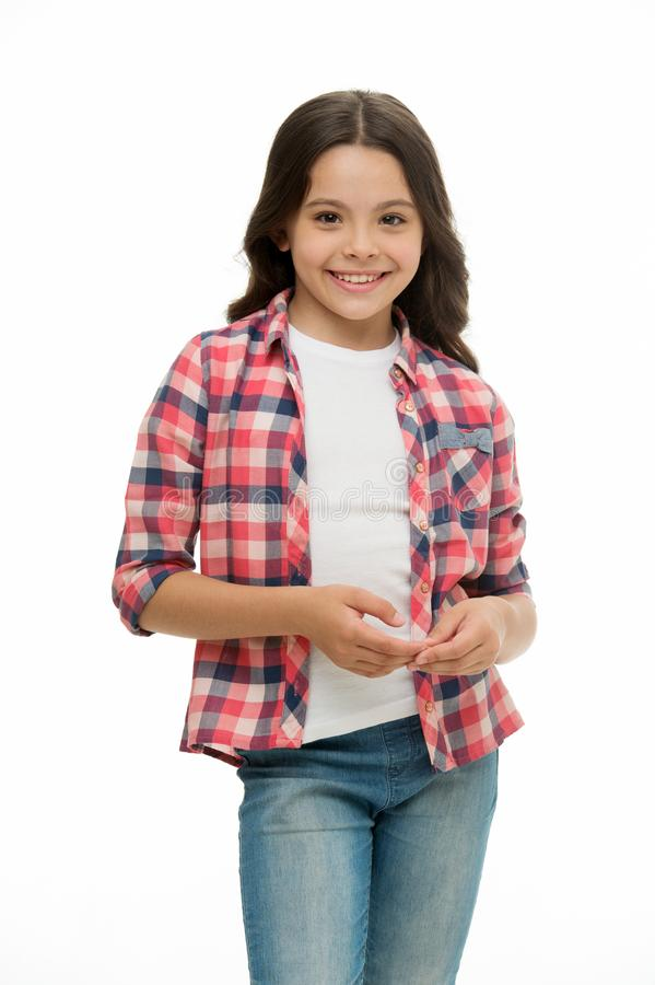 Carefree and casual. Girl cute checkered shirt and denim pants looks happy cheerful. Child girl happy carefree enjoy. Childhood. Kid girl long curly hair royalty free stock photo