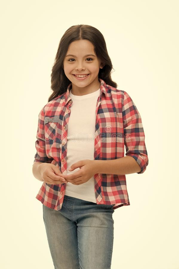 Carefree and casual. Girl cute checkered shirt and denim pants looks happy cheerful. Child girl happy carefree enjoy. Childhood. Kid girl long curly hair royalty free stock photos
