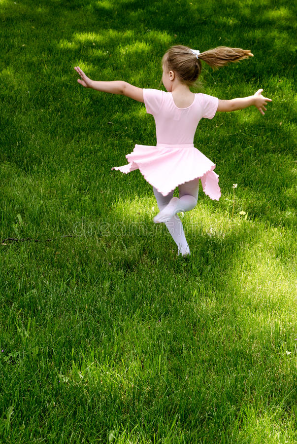 Carefree Child Dancing Stock Photo