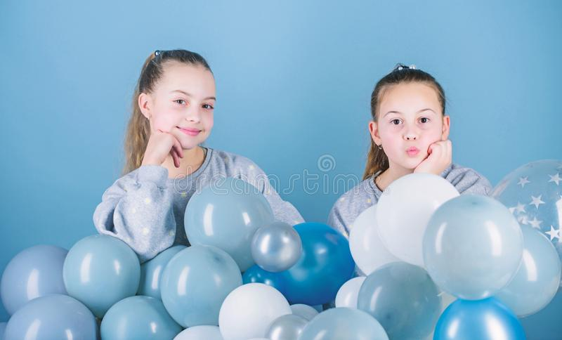Carefree childhood. Sisters organize home party. Having fun concept. Balloon theme party. Girls best friends near air stock images