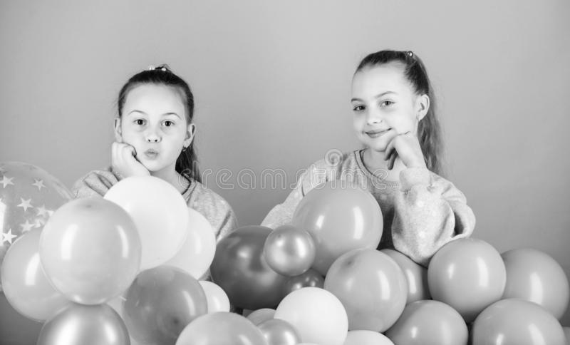 Carefree childhood. Sisters organize home party. Having fun concept. Balloon theme party. Girls best friends near air royalty free stock photography