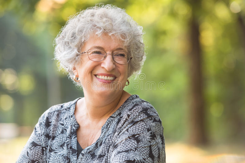 Carefree elderly woman stock image