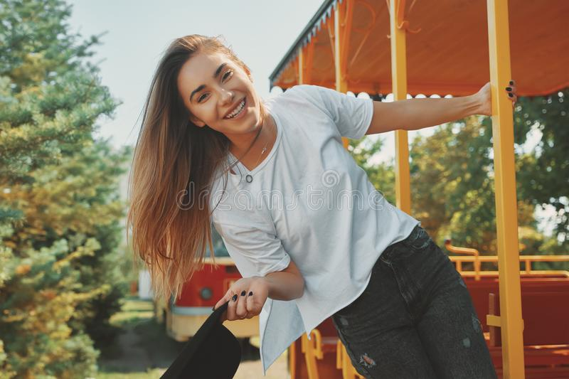 Carefree fashionable young woman enjoying summer adventure and t stock image