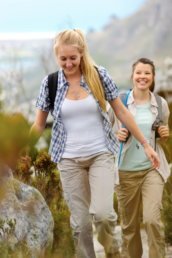 Carefree friends hiking royalty free stock images