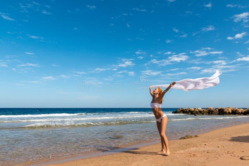 Carefree girl on the beach stock photos