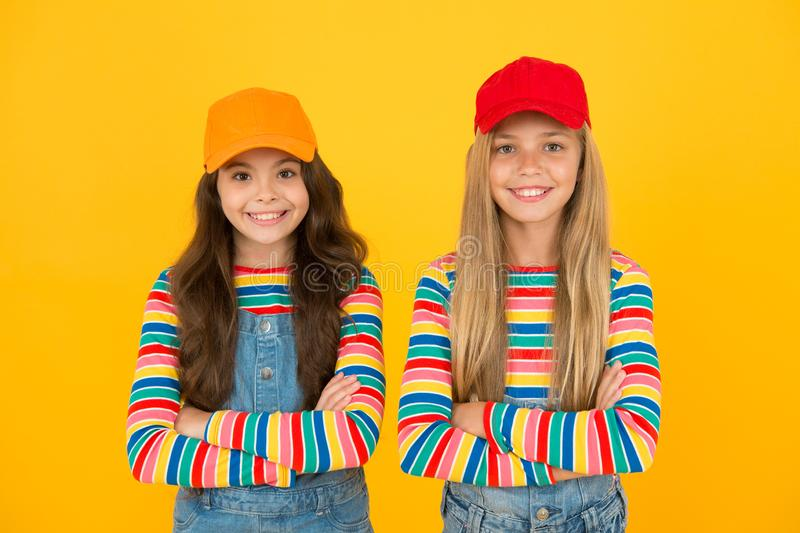 Carefree and happy childhood. Happy childrens day. Family look. Friendly and happy children. Stylish children. International childrens day. Happy smiling girls stock image