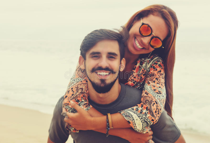 Carefree hippie love couple in vintage summer style royalty free stock image