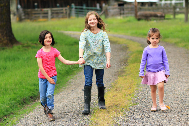 Carefree little country girls stock photos