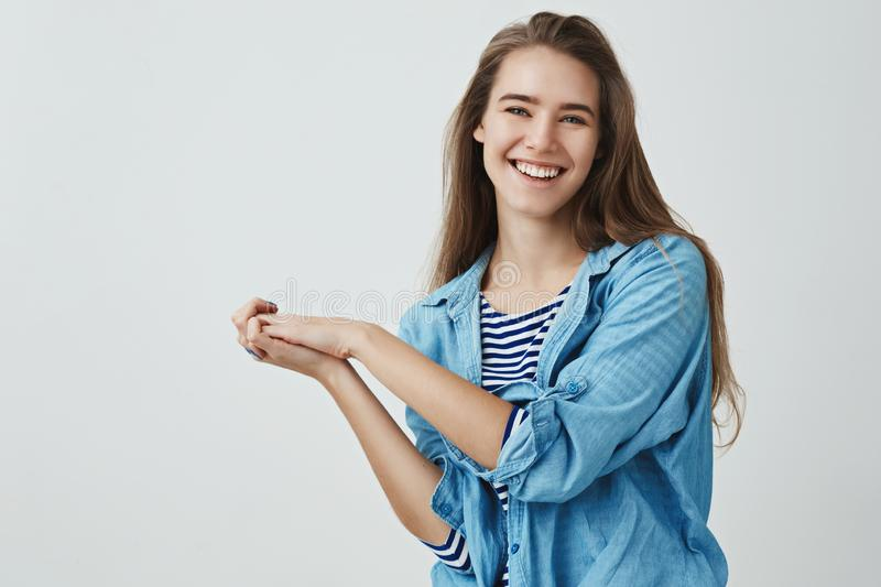 Carefree modern romantic tender girl laughing pressing palms together flirty silly, having fun smiling joyfully stock images