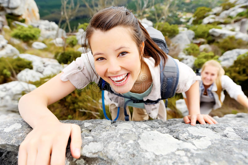 Carefree outdoor climbing woman royalty free stock images