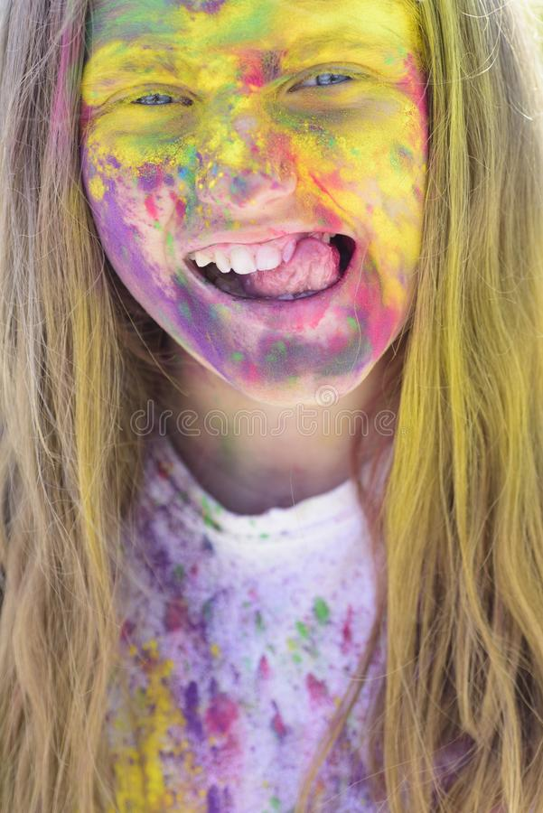 Carefree pastime. Happy life in teenager time. Holidays camp. Emotional girl with happy mood with colorful drycolors. Colorful holi on painted face. Camp and royalty free stock images