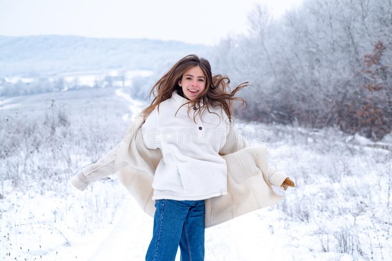 Carefree winter break. Happy moment in winter day. Activity smiling girl playing with snow and having. Happy jumping royalty free stock image