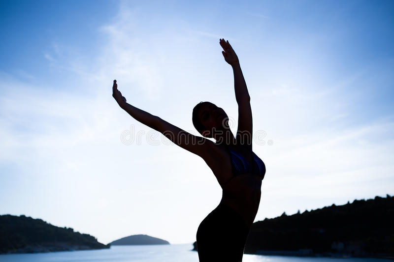 Carefree woman dancing.Vacation vitality healthy living.Free woman embracing the sunshine,enjoying peace,serenity in nature.Beauti royalty free stock photo