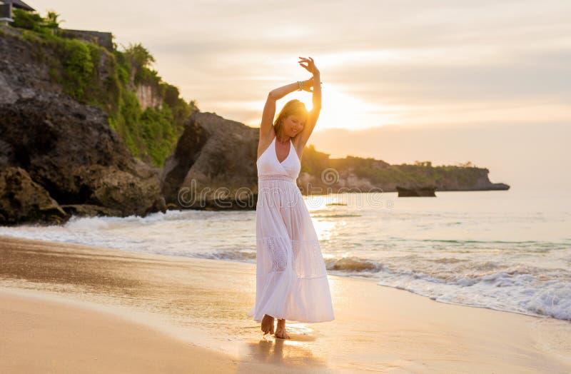 Carefree woman enjoying financial freedom stock images