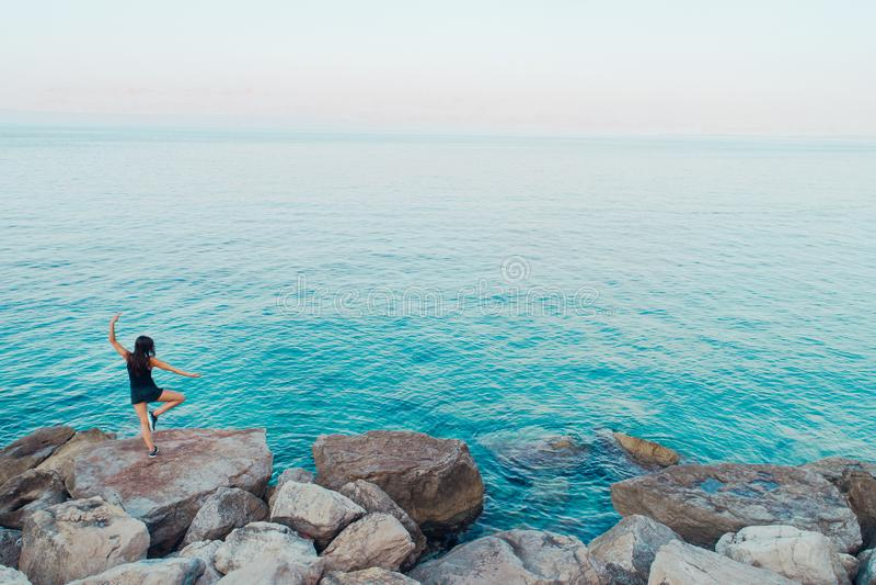 Carefree woman meditating in nature.Finding inner peace.Yoga practice.Spiritual healing lifestyle.Enjoying peace,anti-stress stock photography