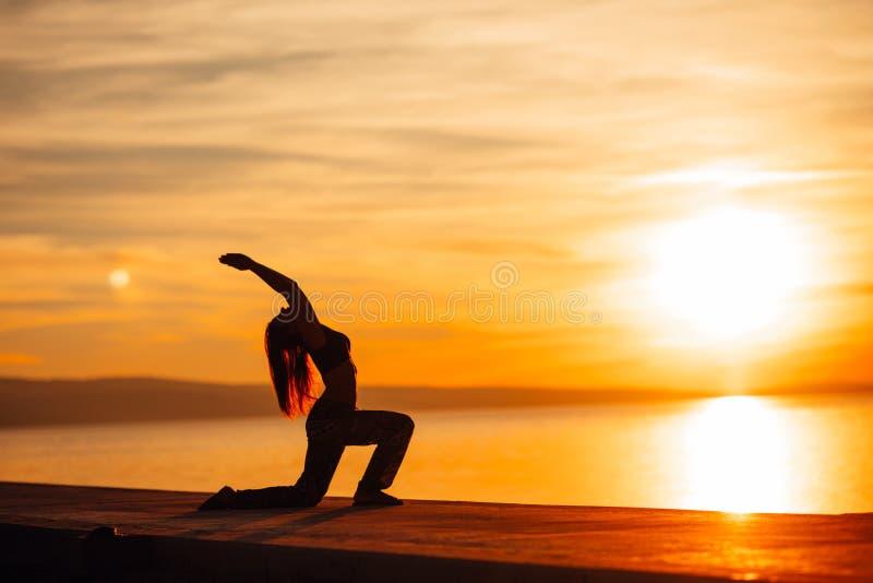 Carefree woman meditating in nature.Finding inner peace.Yoga practice.Spiritual healing lifestyle.Enjoying peace,anti-stress stock photos