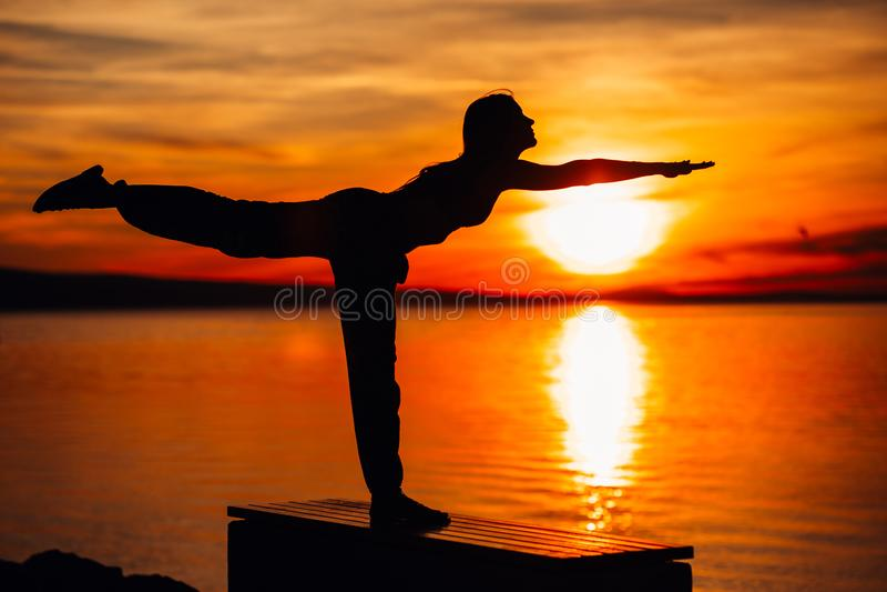 Carefree woman meditating in nature.Finding inner peace.Yoga practicing.Spiritual healing lifestyle.Enjoying peace,anti-stress stock photo