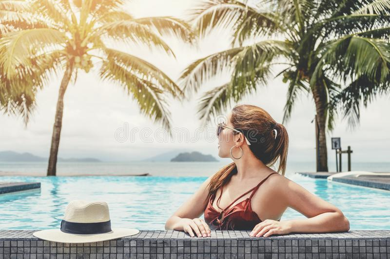 Carefree woman relaxation in swimming pool summer Holiday concept royalty free stock images