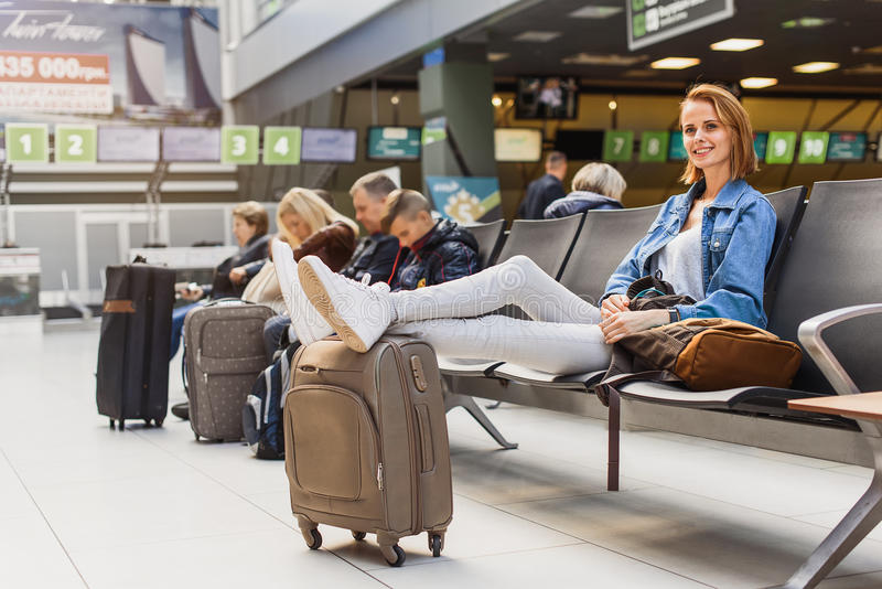 Carefree young woman relaxing in airport stock images