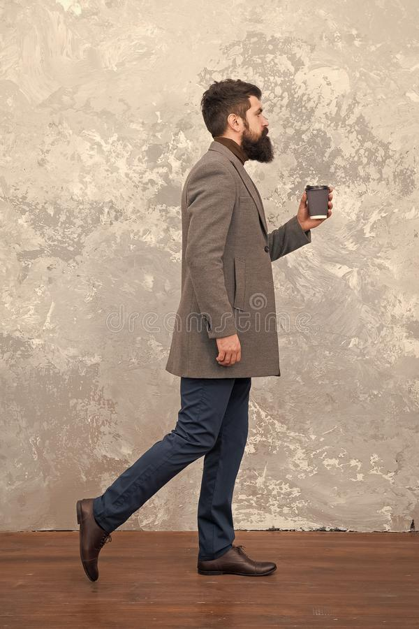 Careful with coffee cup. Man handsome bearded businessman hold cup coffee. Coffee break concept. Business people fashion stock photography